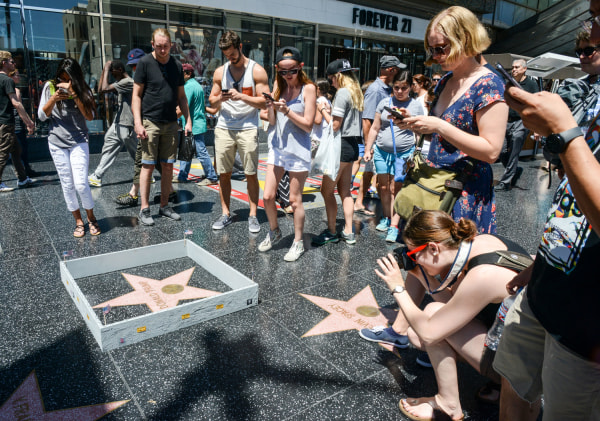 Someone built a wall around Donald Trump's Hollywood star.