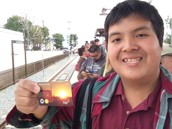 Kenny Uong holds up a special edition TAP card commemorating the extension of the Metro Gold Line.