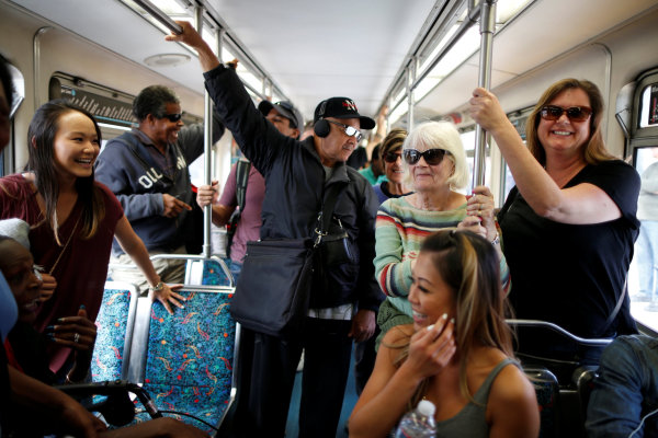 Image: People ride a train on L.A. Metro's new $1.5 billion Expo Line extension that connects downtown to the beach for the first time in 63 years, in Santa Monica