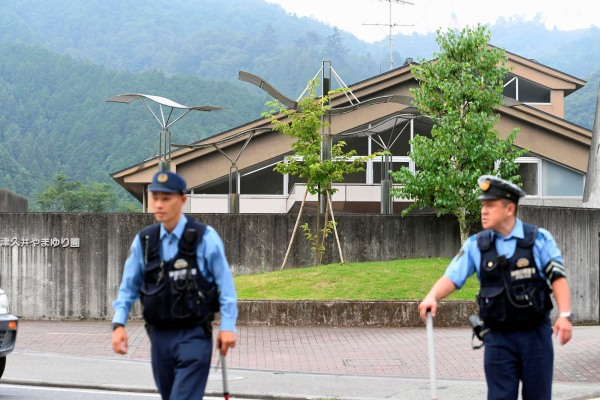 Image: Police officers are seen in front of a facility for the disabled where at least 19 people were killed and as many as 20 wounded by a knife-wielding man, in Sagamihara, Kanagawa prefecture, Japan