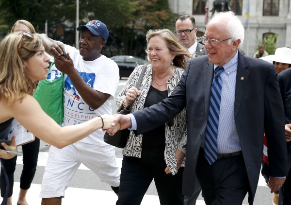 Image: Sen. Bernie Sanders, I-Vt., right, shakes hands with a supporter in downtown Philadelphia, Thursday, July 28, 2016, during the final day of the Democratic National Convention.