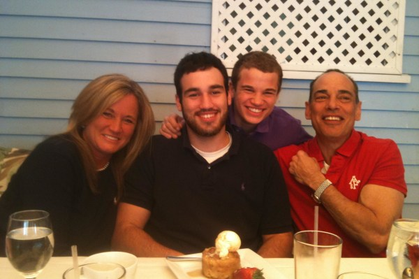 Taylor Stewart (black polo shirt) and his family.