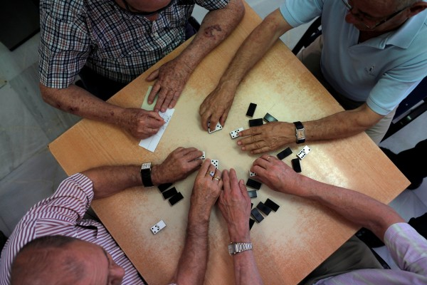 "Image: Pensioners play dominoes at ""Anica Torres"" seniors centre in Benalmadena"