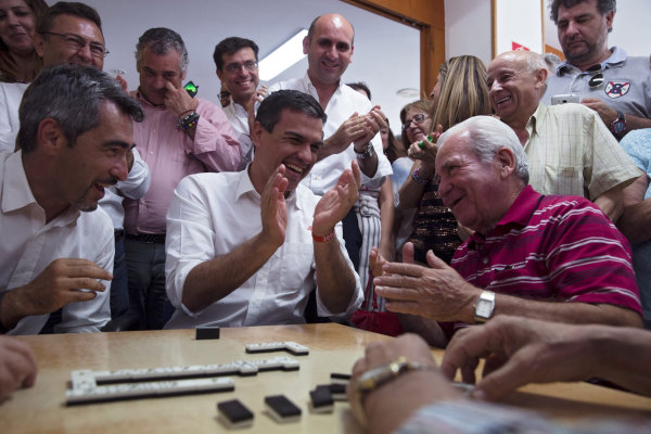 Politicians join Senior Citizens for Game of Dominoes
