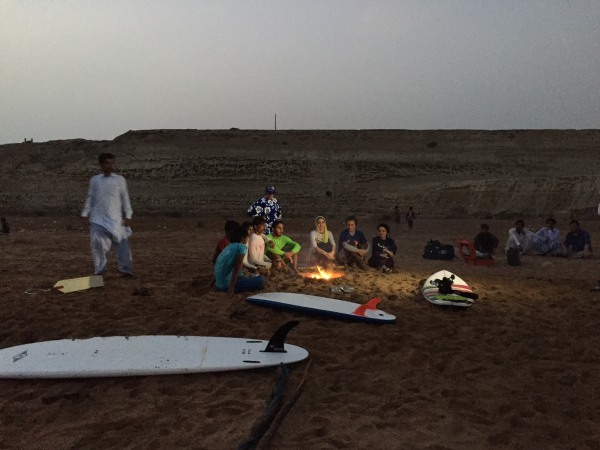 Image: Members of Iran's unnamed surfing club sit around a fire