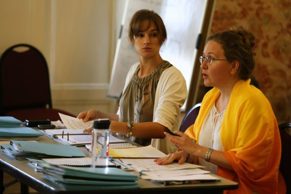 Yahima Leblanc, right, and Kelsey Roberts, lead an orientation sessions for recent Cuban arrivals
