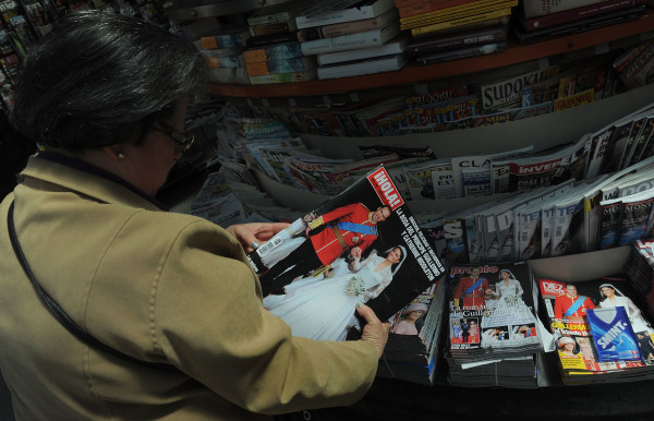 A woman looks at the front cover of Spanish magazine ?Hola!