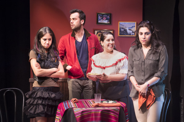 Connie Saltzman (Jenny), Andres De Vengochea (Kevin), Gladys Perez (waitress) and Vanessa Verduga (Sara) in a scene from off-Broadway comedy Implications of Cohabitation.