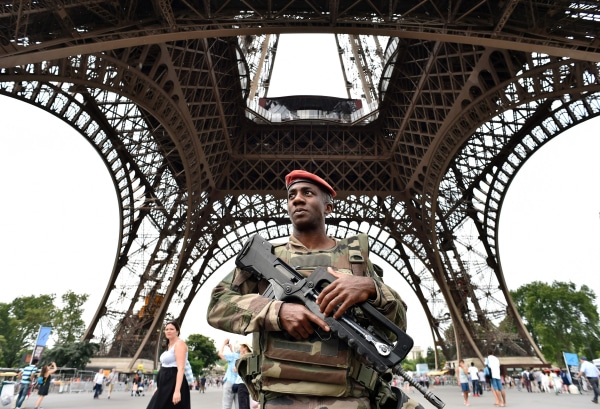 Image: French soldier patrols under Eiffel Tower on July 20, 2016