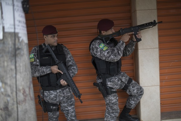 Image: A police operation in Vila do Joao slum of Rio de Janeiro on Aug. 11, 2016