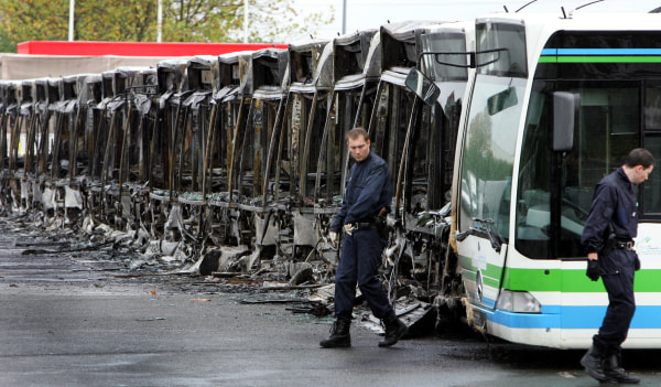 Image: Burned buses in Trappes, France