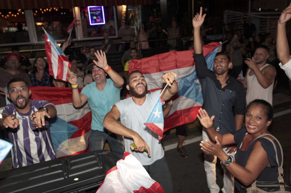 Puerto Ricans celebrate the gold medal won by Monica Puig