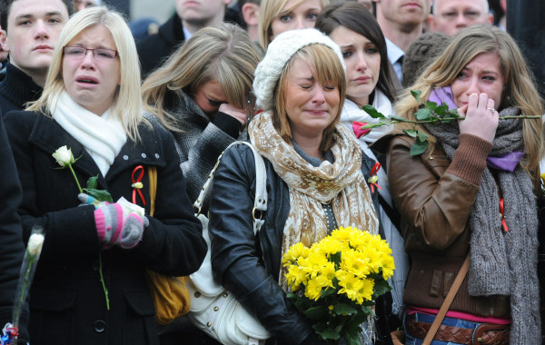 Image: Mourners react as hearse carrying British soldier Robert Hayes is driven through Wootton Bassett on Jan. 11, 2010
