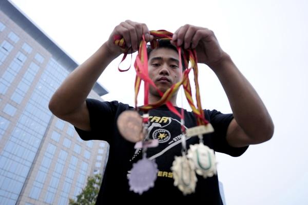 Image: Former gymnastics world champion Zhang Shangwu