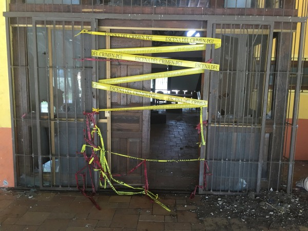 Police tape is seen at the entrance of a ranch where a firefight of armed civilians with federal forces at a ranch in Tanhuato