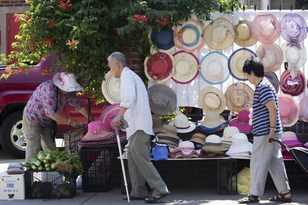 Customers stroll by sidewalk shops set up in Philadelphia's industrial Chinatown area.