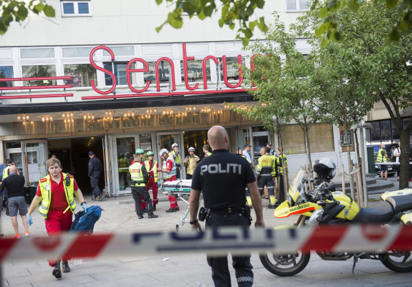 Image: Police and emergency personnel gather at the entrance of a concert venue, Setrum Scene