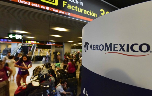 File photo: Passengers wait to get a seat on a Aeromexico airways's flight.