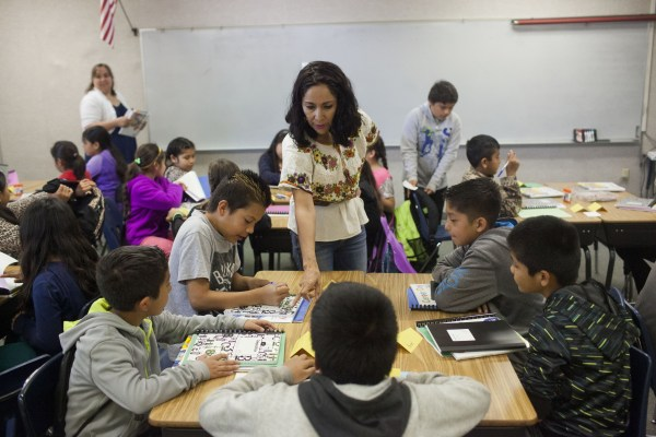 An exchange teacher from Mexico instructs refugee students.