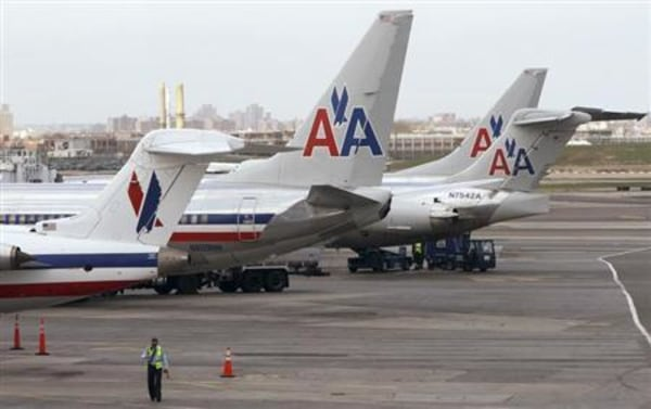 American Airlines aircraft sit on the tarmac at LaGuardia airport following a reservation system outage in New York