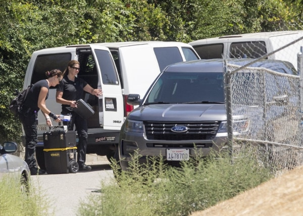 Image: Police arrive at Chris Brown's house