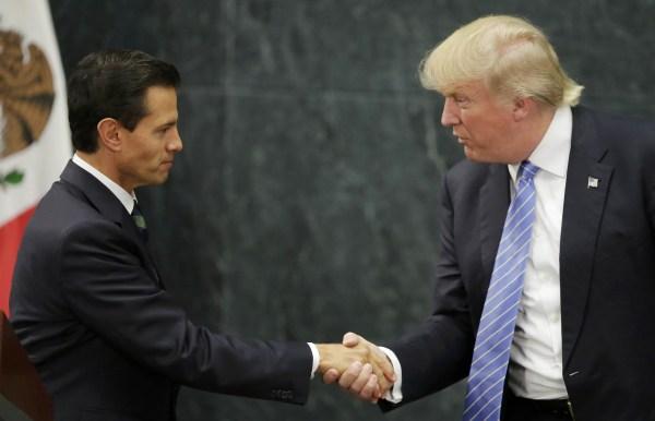 Image: U.S. presidential nominee Trump and Mexico's President Pena Nieto shake hands in Mexico City
