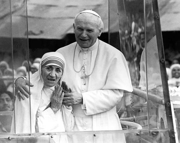 Image: Pope John Paul II, right, holds his arm around Mother Teresa