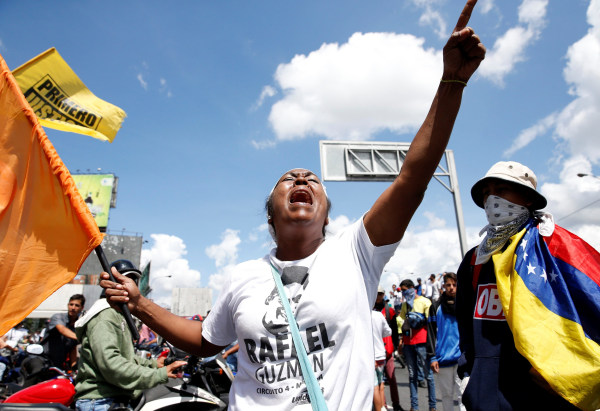 Protesters yell slogans during a rally to demand a referendum to remove Venezuela's President Nicolas Maduro in Caracas, Venezuela