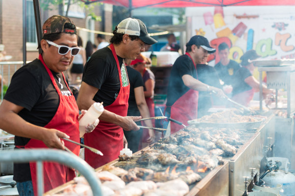 File photo: People grilling
