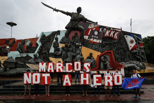 Image: Filipinos protest against the late dictator Ferdinand Marcos' hero's burial on National Hero's Day