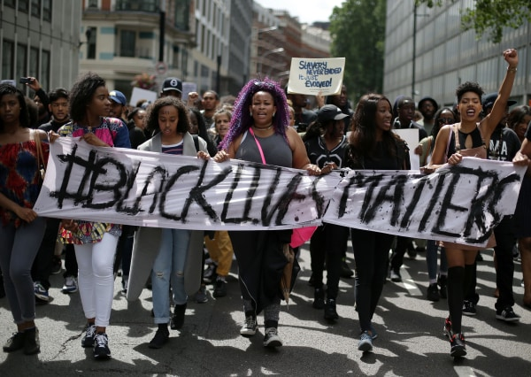 Image: Demonstrators from the Black Lives Matter movement march through the streets of central London