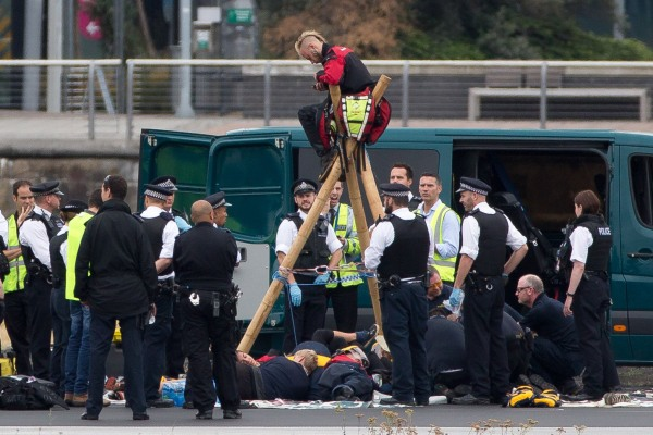 Image: Emergency services surround protesters at London City Airport
