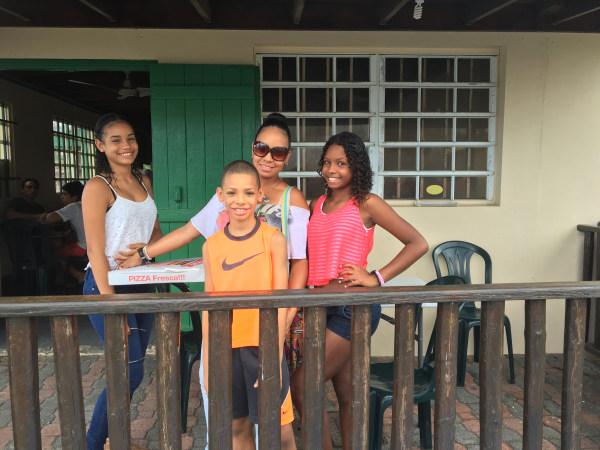 Michelle Skerrett, 46 with her three kids in Luquillo, Puerto Rico.