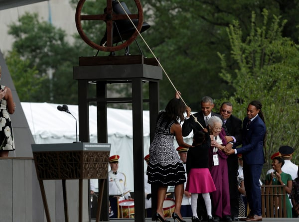 Image: U.S. President Barack Obama with First Lady Michelle Obama and the Bonner family ring the onstage bell during dedication and grand opening of the Smithsonian Institution's National Museum of African American History and Culture in Washington