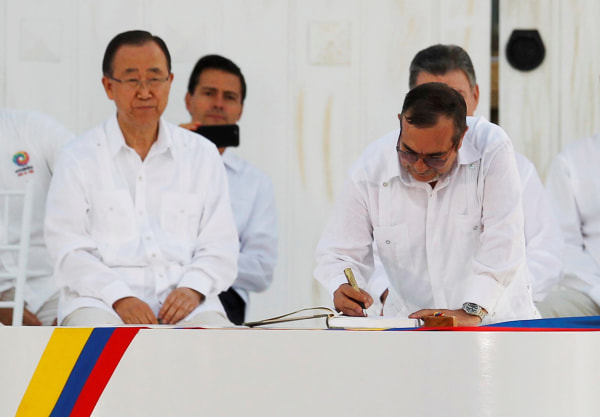 Image: Marxist rebel leader Londono signs accord ending a half-century war that killed a quarter of a million people, in Cartagena