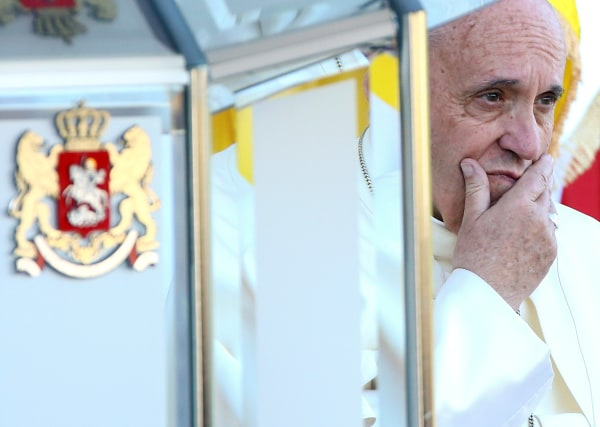 Image: Pope Francis looks on during a welcome ceremony at the Presidential palace in Tblisi