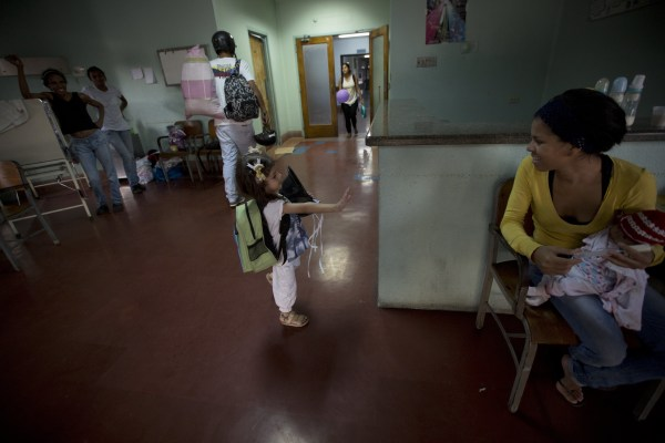 In this Sept. 19, 2016 photo, 3-year-old Ashley Pacheco waves goodbye after she was discharged from University Hospital in Caracas, Venezuela.
