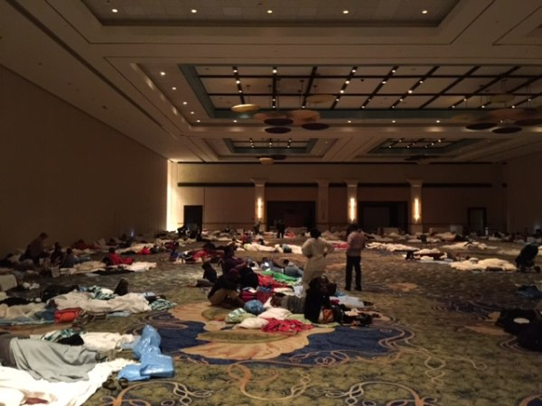 Because of Hurricane Matthew, guests at the Atlantis Resort in Nassau were told on Wednesday evening to evacuate the towers of the hotel. They were placed in a large conference room to spend the night.
