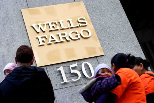 Protestors gather outside the Wells Fargo & Co corporate campus in New York