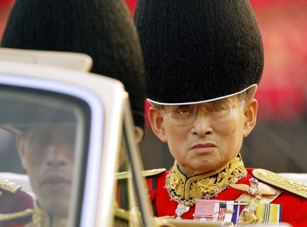 Image: A 2003 file picture shows Thailand's King Bhumibol Adulyadej as his son, Crown Prince Maha Vajiralongkorn, looks on