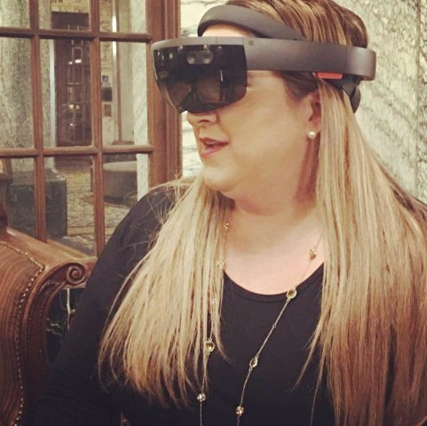 Cathy Hackl using a Holo Lens virtual reality headset.