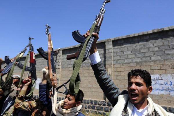 Image: Armed Houthis brandish weapons in Sanaa, Yemen, on Oct. 2.