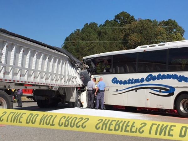 A tour bus with 48 people aboard collided with a truck