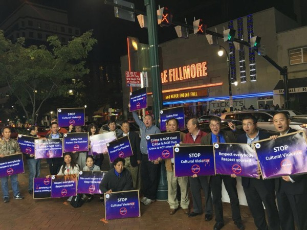 Between 30 and 50 Chinese Americans protest outside a YG rap concert Wednesday at The Fillmore in Silver Spring, Maryland.