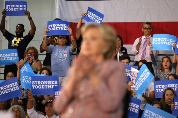 Image: Supporters listen to U.S. Democratic presidential nominee Clinton and former Vice President Al Gore talk about climate change at a rally at Miami Dade College in Miami