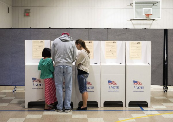 Image: A man votes during the primary election in Idaho