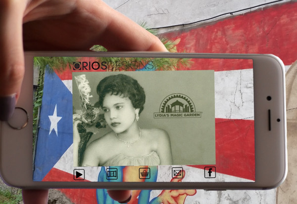 "Oliver Rios' augmented reality photo of his mother Lydia in front of the wall of her famous garden - part of ""Mi Querido Barrio"" portion of ""Home, Memory, Future."""