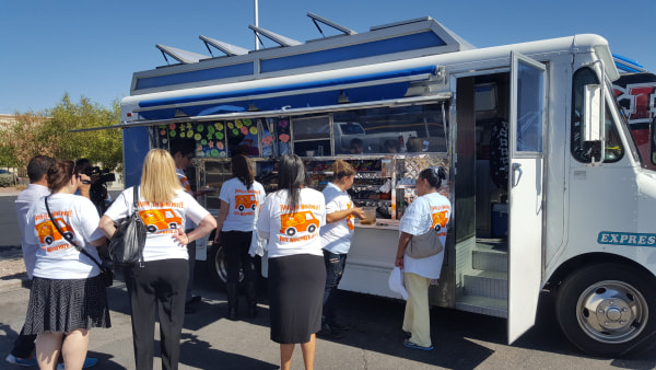 Volunteers and patrons lining up for the taco truck voter registration drive in Nevada.