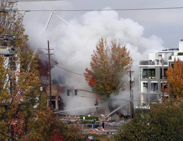 Image: Smoke rises as firefighters battle a blaze after a gas explosion in Portland