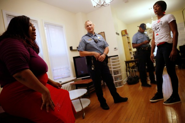 Image: Hawkins speaks with Corado at a home where she shelters transgender women of color in Washington